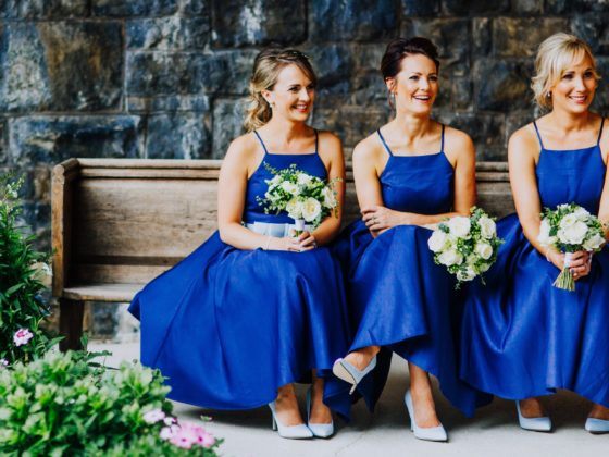 Bridesmaids sitting on a bench