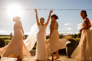 Bride and bridesmaids outdoors