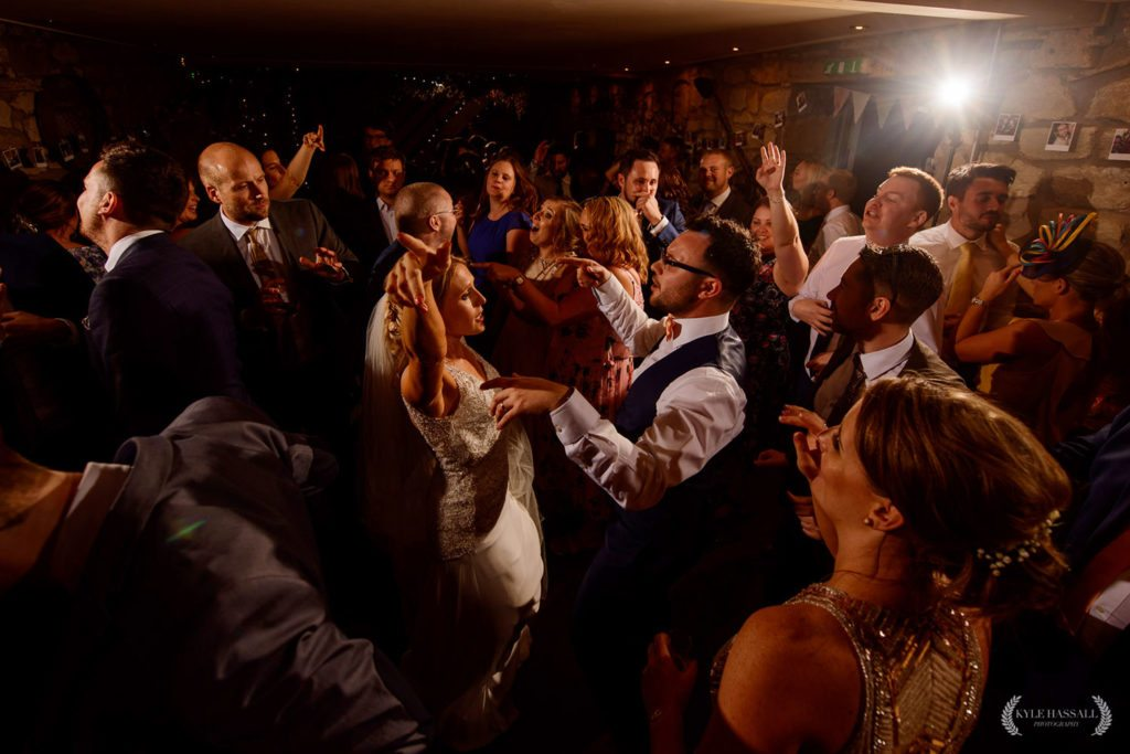 Bride and Groom dancing alongside other guests