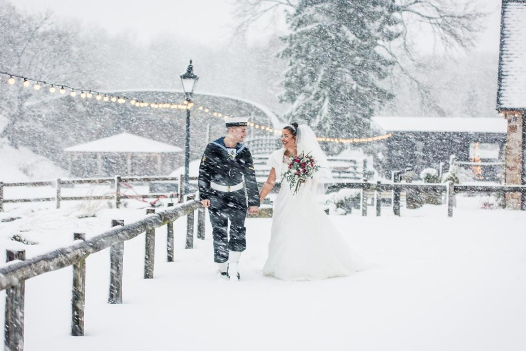 Bridge and groom walking through the snow
