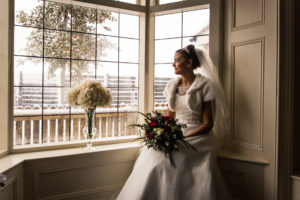Bride sat looking out the window
