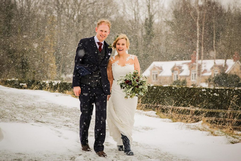 Bride and groom walking in the snow