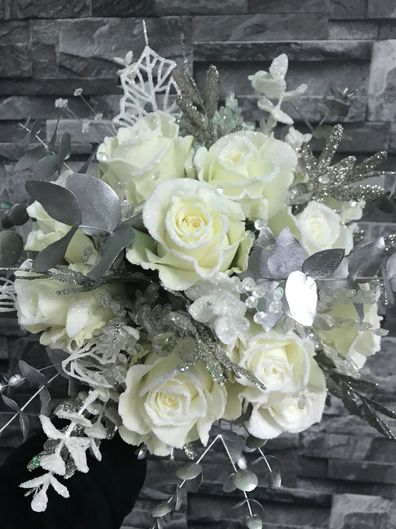 Silver and white arrangement of flowers