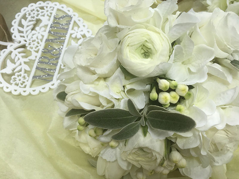 A white arrangement of flowers