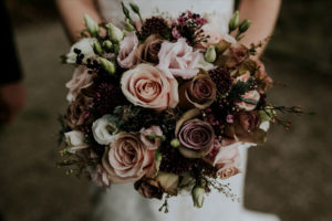 bunch of flowers held by bridesmaid