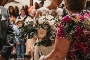 Bride gold bouquet of flowers with family