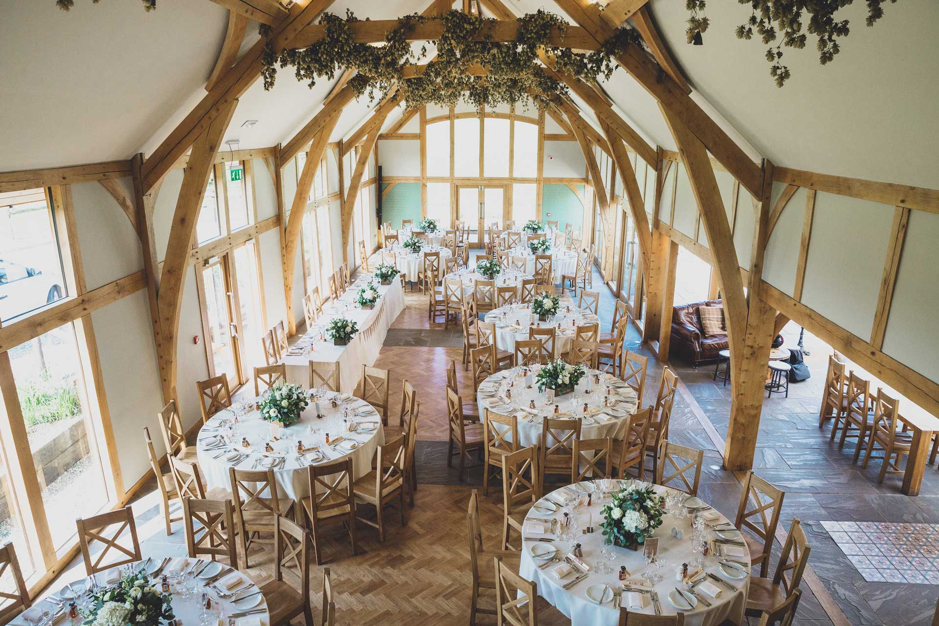 Pre-set tables ready in a wooden styled room