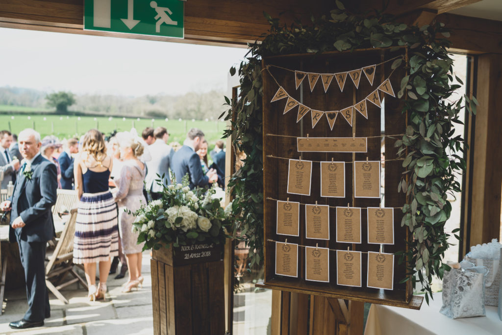 rustic wedding seating chart at Tower Hill Barns