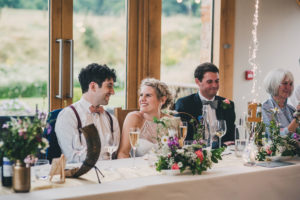 Pretty bridal top table in the oak barns at Tower Hill with Claire Penn Photography