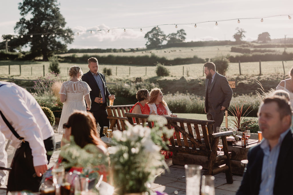 A summer wedding on the outdoor terrace and bar area at Tower Hill Barns with Love Luella photography