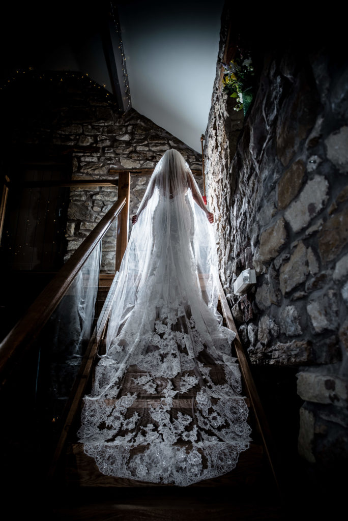 Our stunning bride Ellie on the stairs of the Old Barn here at Tower Hill Barns, photography by Joe Bickerton