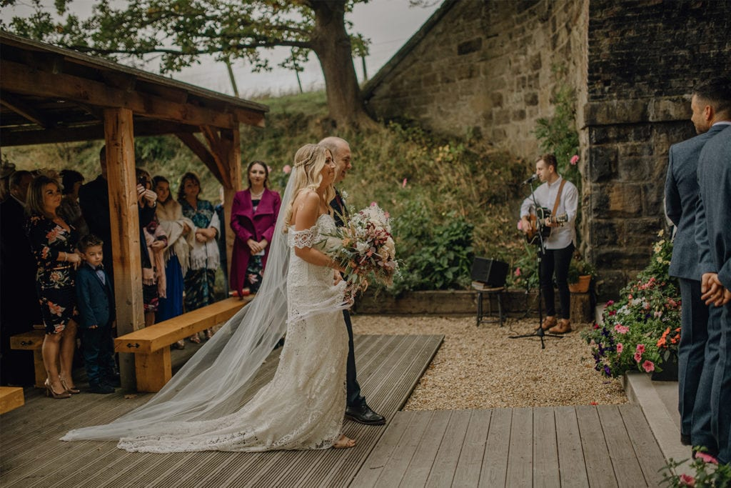 Stunning outdoor ceremony at Tower Hill Barns with flowers by Sass Flowers