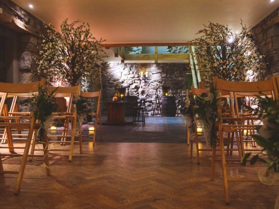 indoor ceremony room at Tower Hill Barns styled by Vivid Floral Wrexham