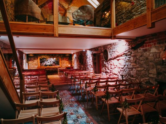 Intimate indoor wedding ceremonies at Tower Hill Barns, North Wales