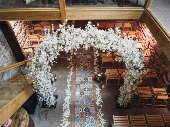 Flower archway over the aisle - Weddings at Tower Hill Barns