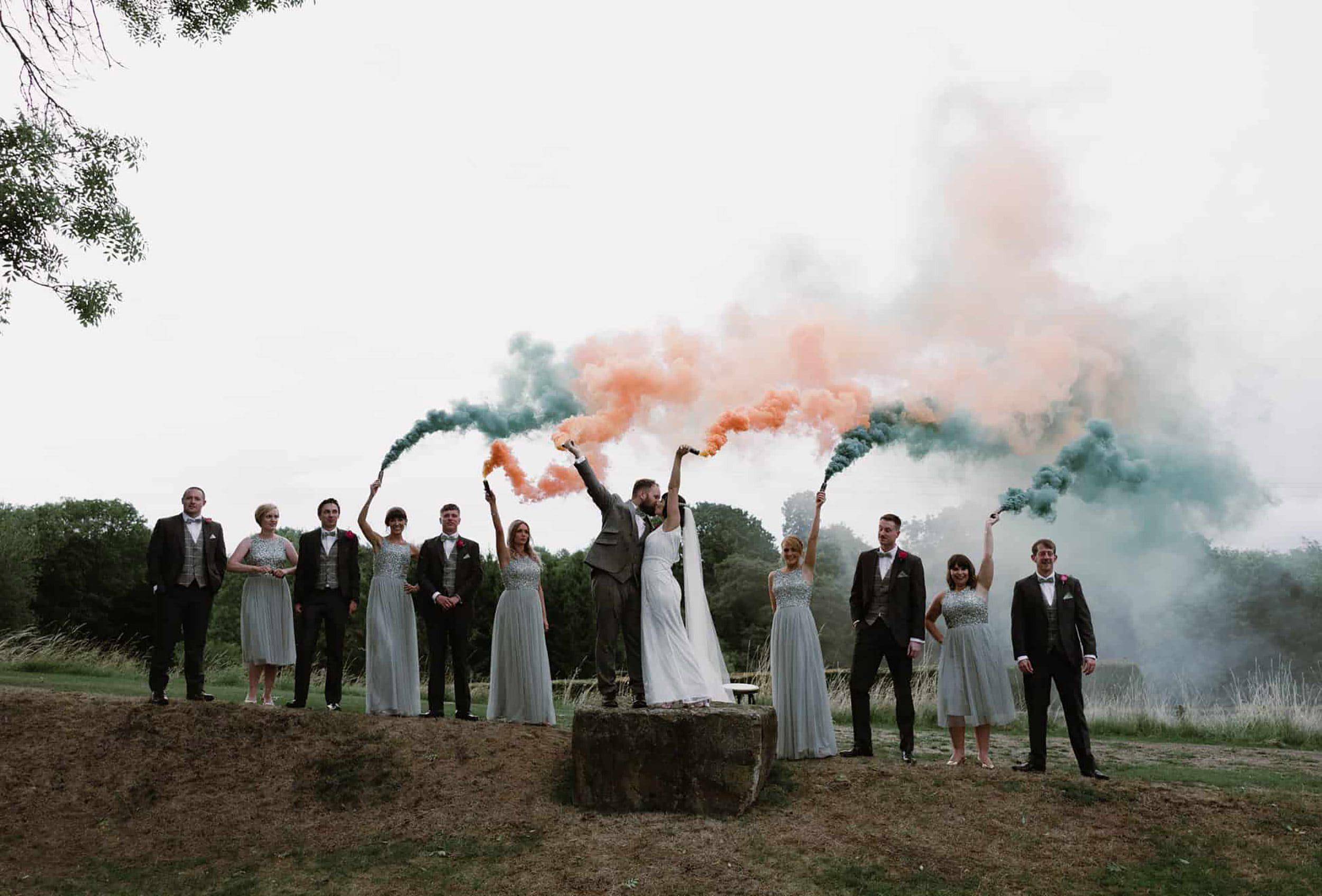 Smoke bomb wedding photography at Tower Hill Barns by Damian Brandon photography