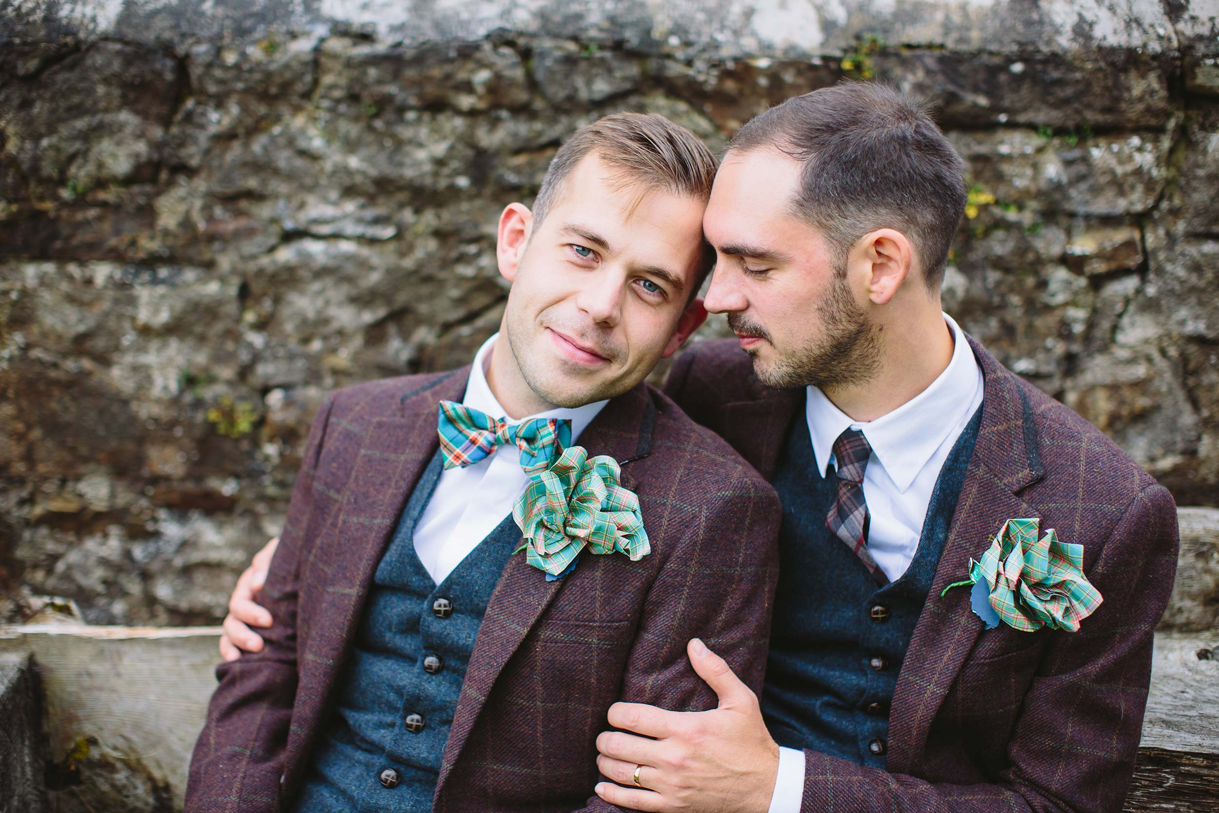 same-sex couple Tim & Tom at Tower Hill Barns photographed by Barnaby Aldrick in striking tartan and suede wedding combo