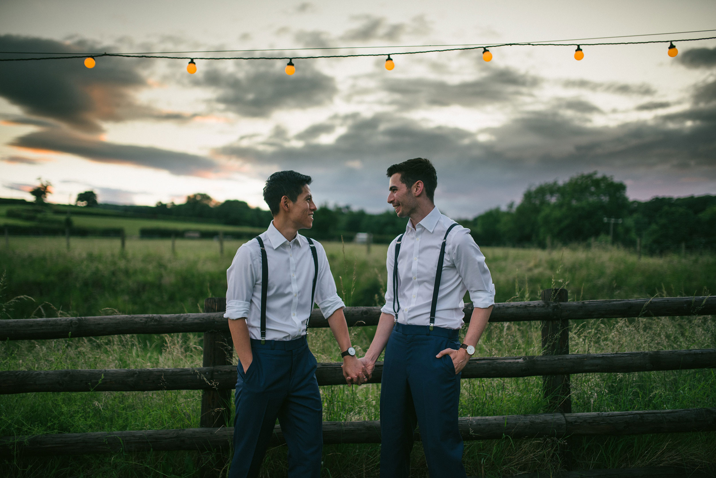 golden hour photo of gay couple Sean & Eric during their same-sex wedding at Tower Hill Barns, shot by Che Birch-Hayes