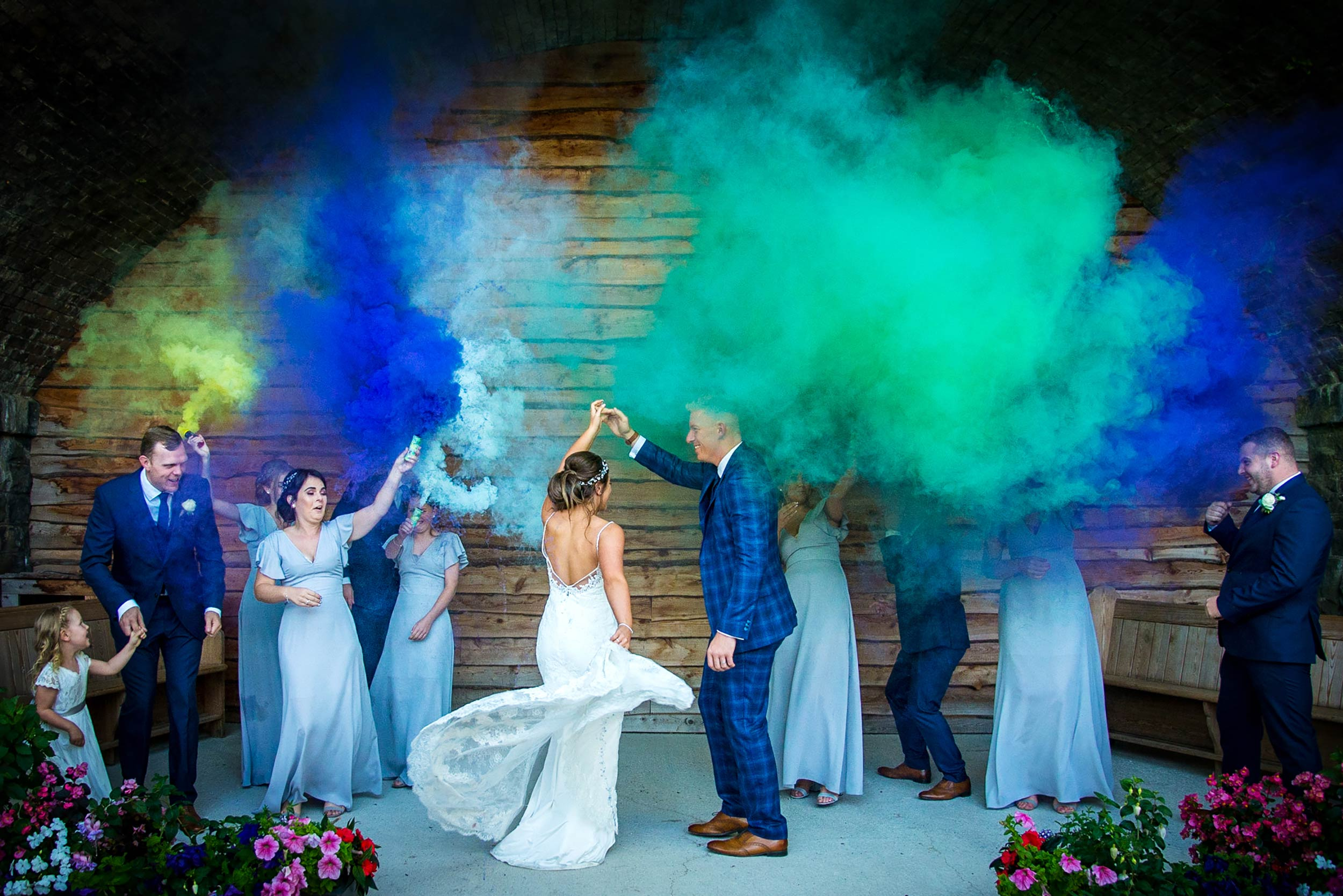 wedding photo by Stacey Oliver Photography of smoke bombs during couples wedding shoot at Tower Hill Barns