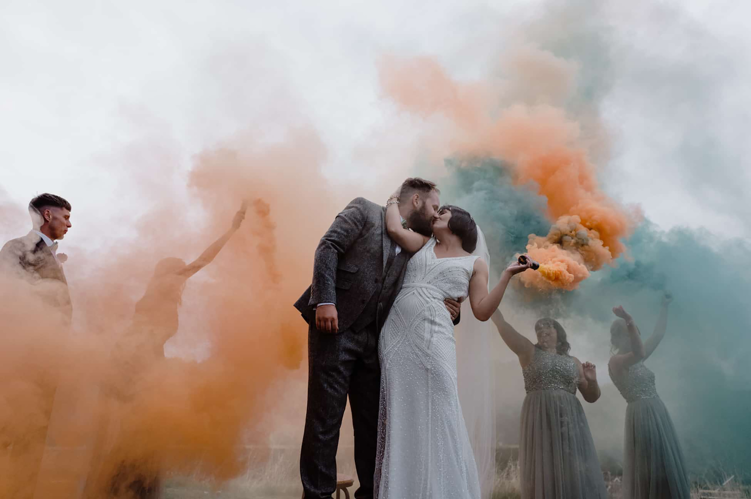 art deco inspired wedding photography by Damian Brandon at Tower Hill Barns with pastel coloured smoke bombs
