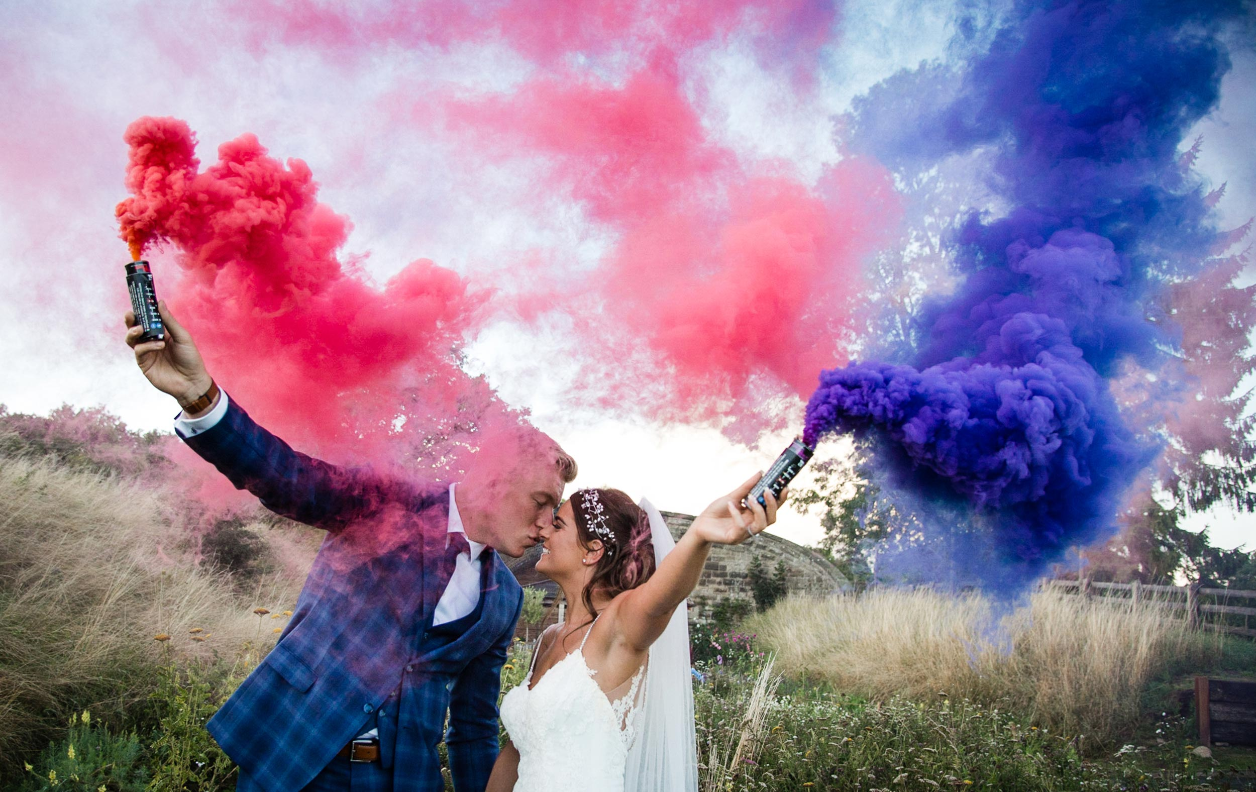wedding photography by Stacey Oliver at Tower Hill Barns during an outdoor ceremony using colourful smoke bombs