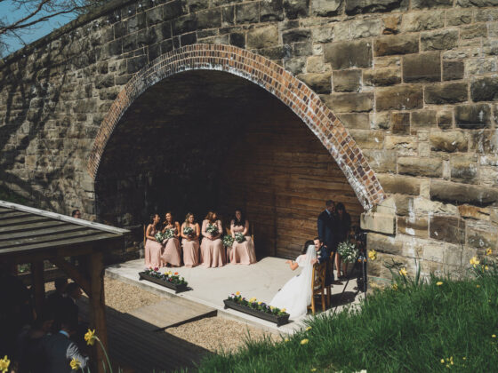 Outdoor weddings under the railway bridge at Tower Hill Barns, North Wales