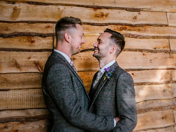 same-sex couple celebrating their gay wedding at Tower Hill Barns in North Wales