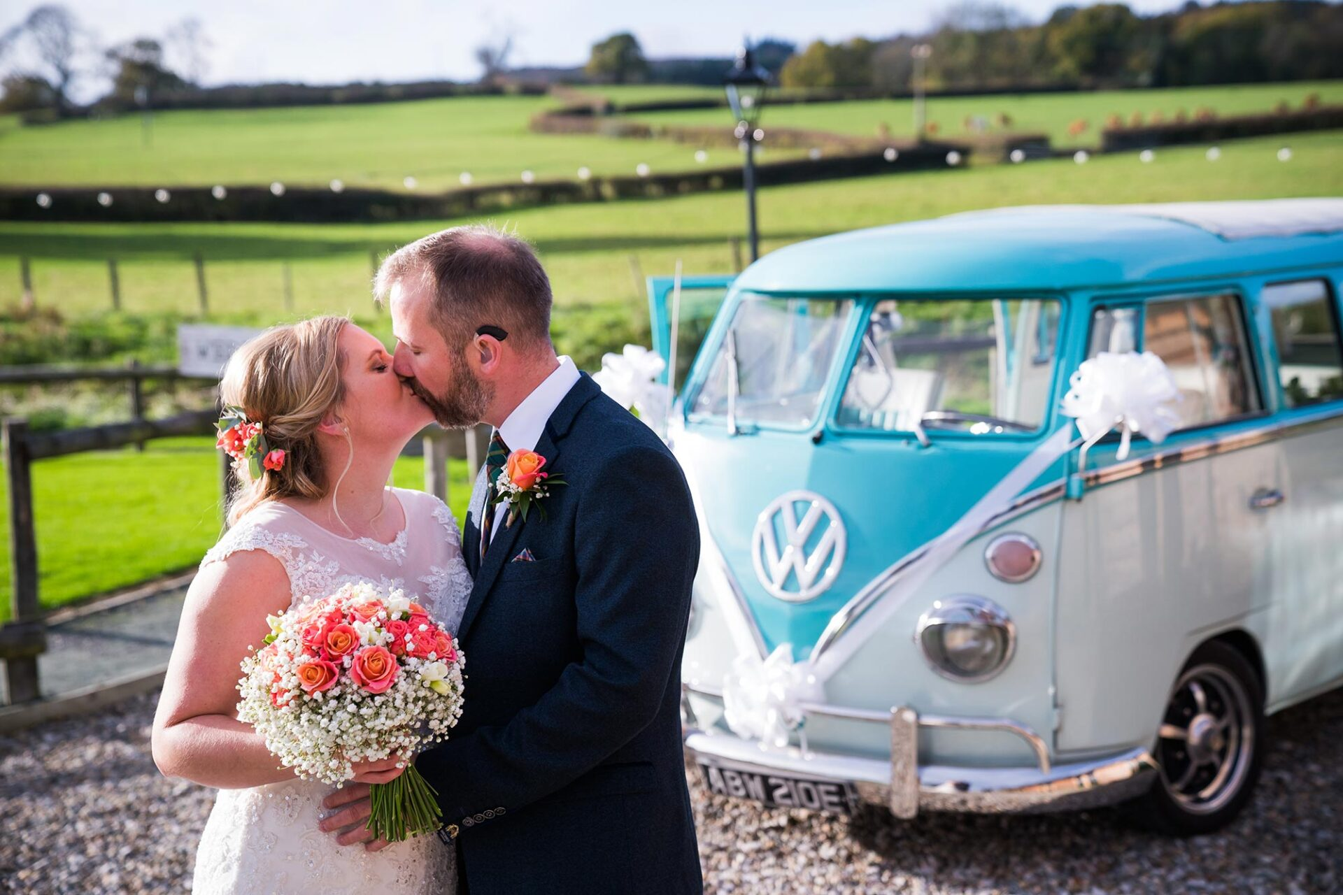 newlyweds Jane & Conor with their Split The Difference VW Campervan wedding car; Tower Hill Barns