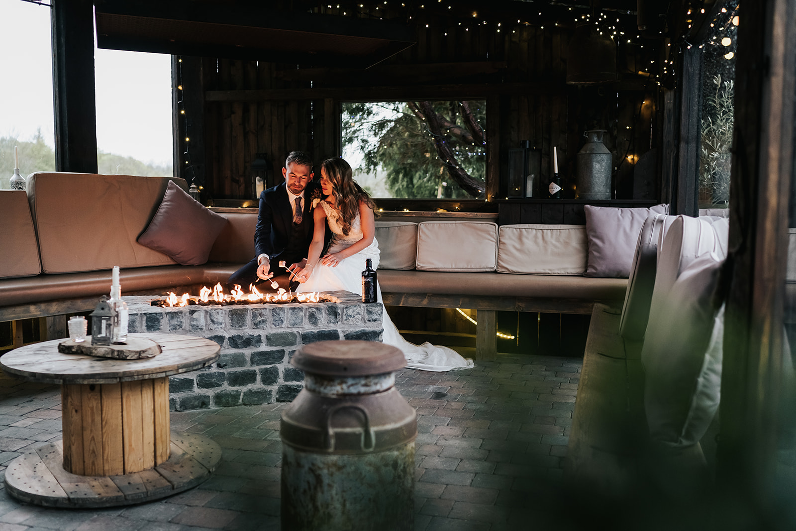 bride and groom toasting marshmallows in the outdoor bar - Tower Hill Barns - winter wedding