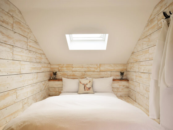 The bed area inside our glamping lodges at Tower Hill Barns, North Wales