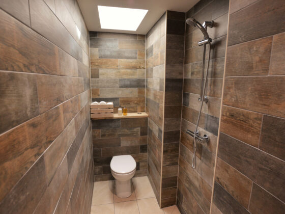 Wetroom in our glamping lodges (On-site Wedding Accommodation) - Tower Hill Barns, North Wales