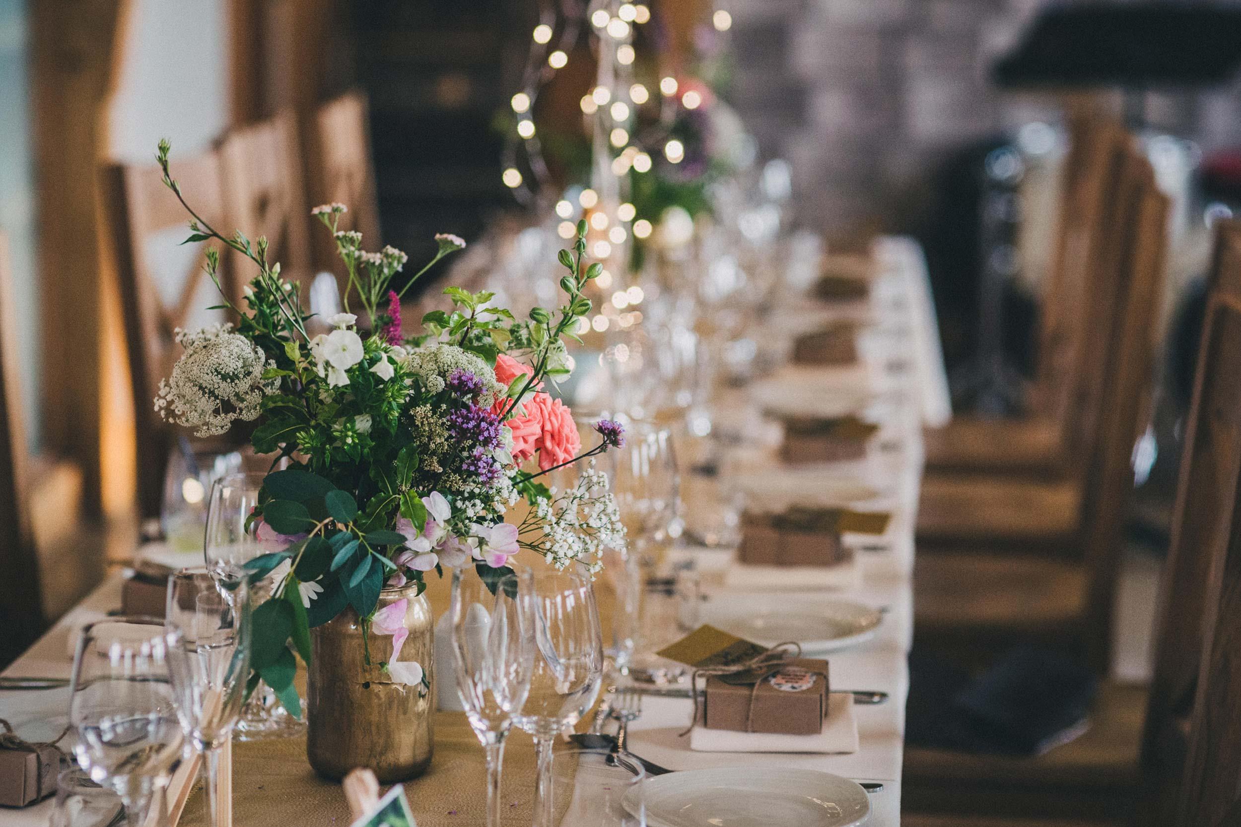 Colourful wedding flower decor for a same-sex wedding; Claire Penn photography