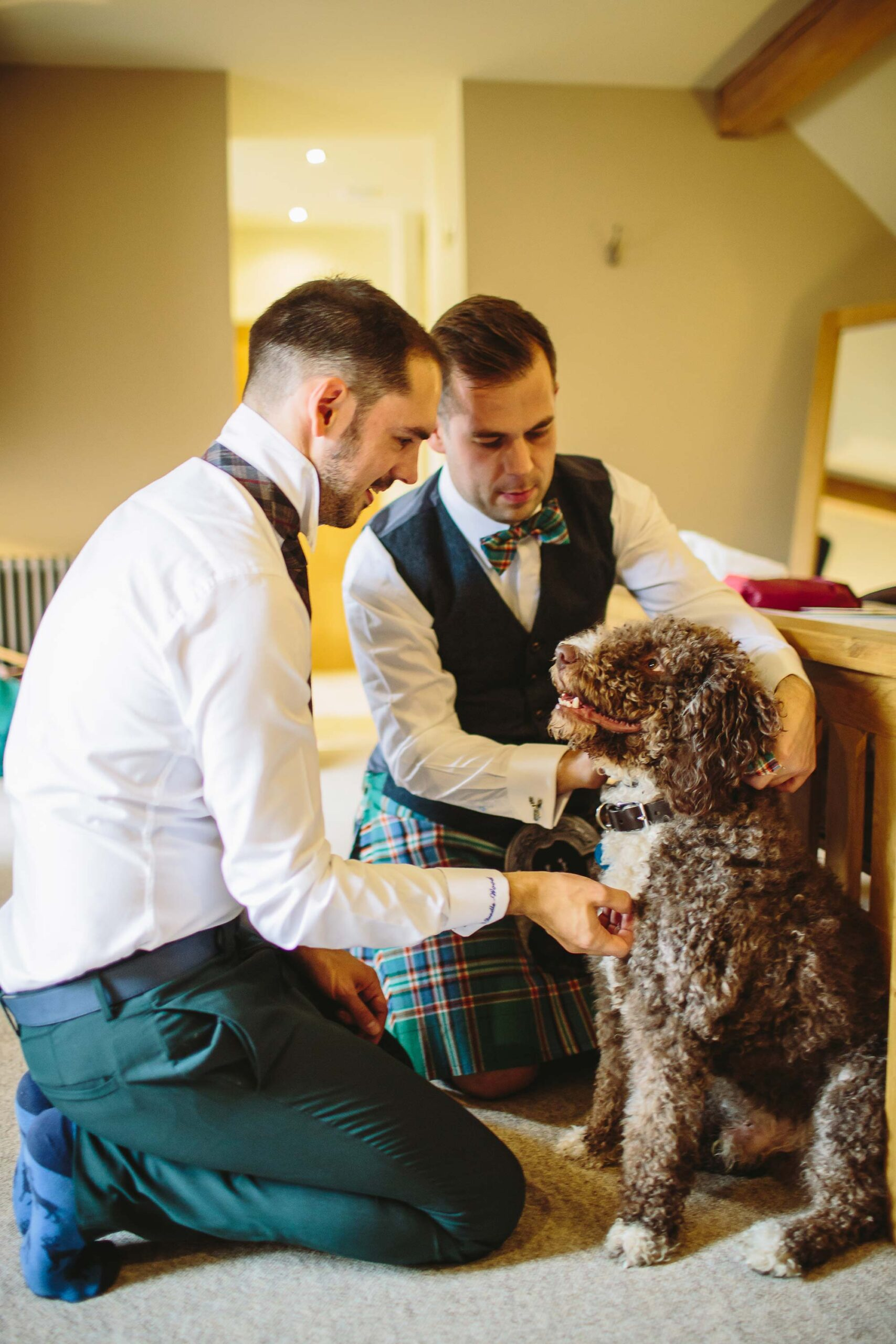 same-sex couple getting ready with their dog before their wedding at Tower Hill Barns; photo by Barnaby Aldrick